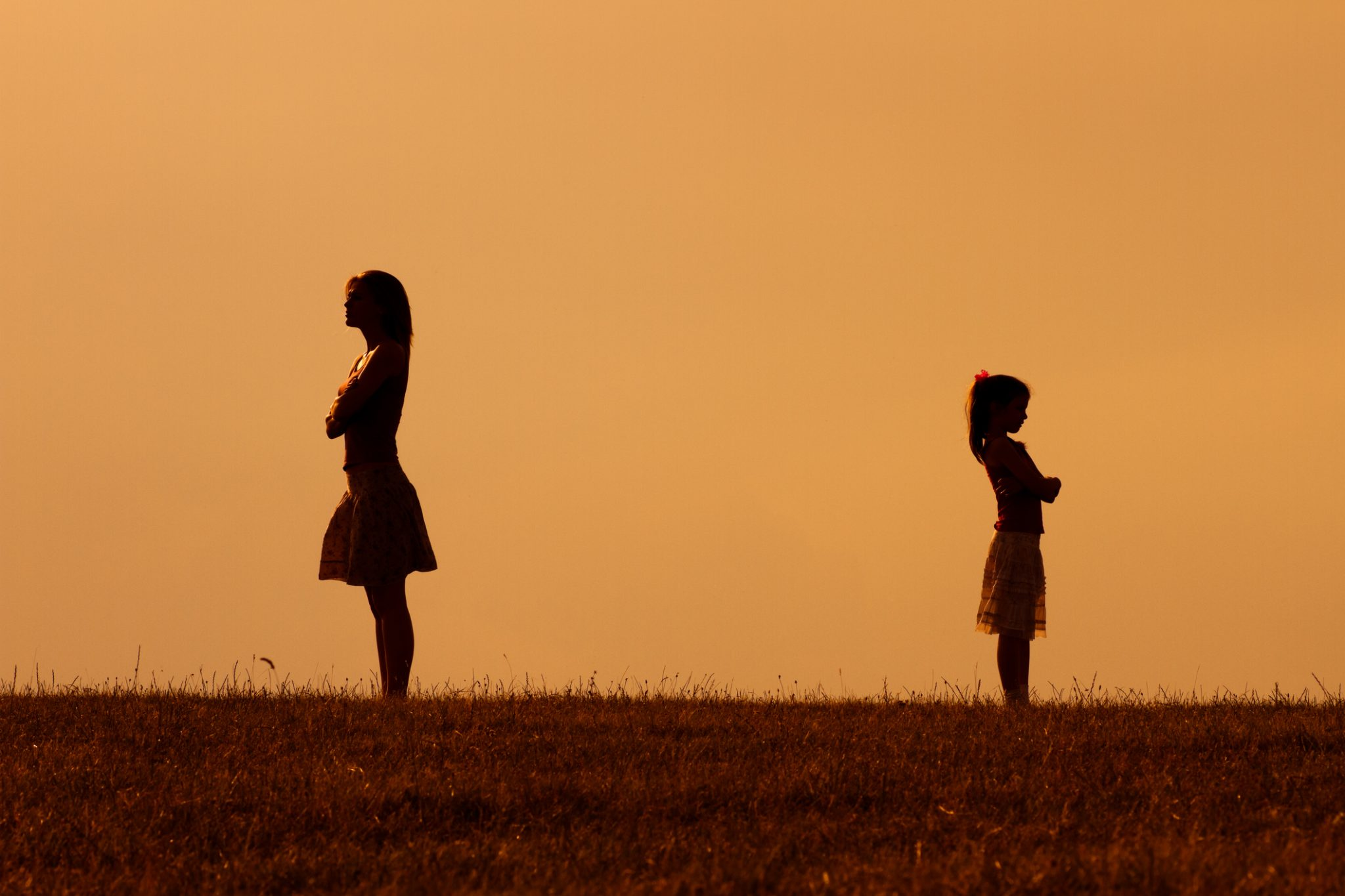 Silhouette of a angry mother and daughter on each other.